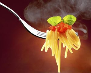 Fork with spaghetti tomato and basil