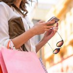 Women carrying shoppings bags and using smartphone, Retail, Shopping, Women, Only Women, Fashion, texting, smartphone, city